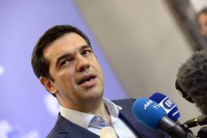 Greek Prime Minister Alexis Tsipras speaks to the press at the end of an Eurozone Summit over the Greek debt crisis in Brussels on July 13, 2015. Juncker said there was no longer any risk of Greece crashing out of the euro after Athens agreed a bailout deal with eurozone partners.  AFP PHOTO / THIERRY CHARLIER